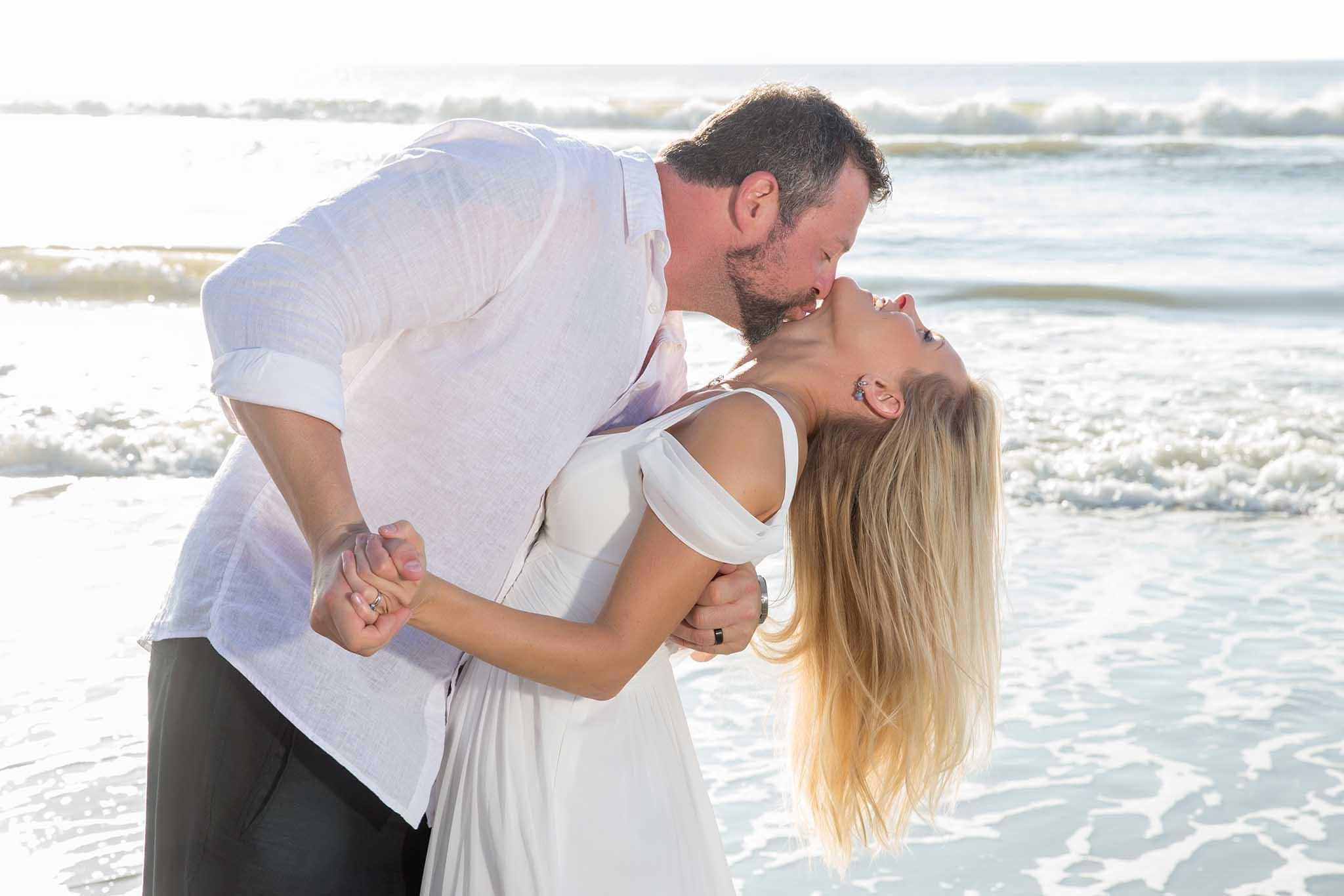 groom is kissing the bride