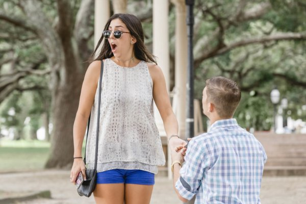 engagement photo Charleston she is super excited and surprised with proposal in Gazebo