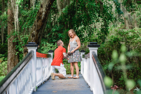 engagement photo Charleston they are staying on the bridge the moment of proposal