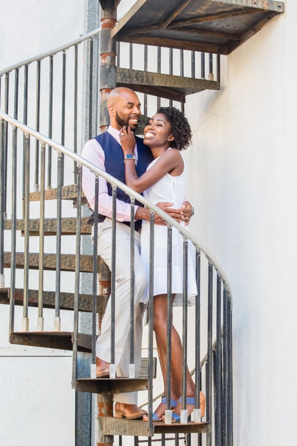 engagement photo Charleston they are hugging on stairs