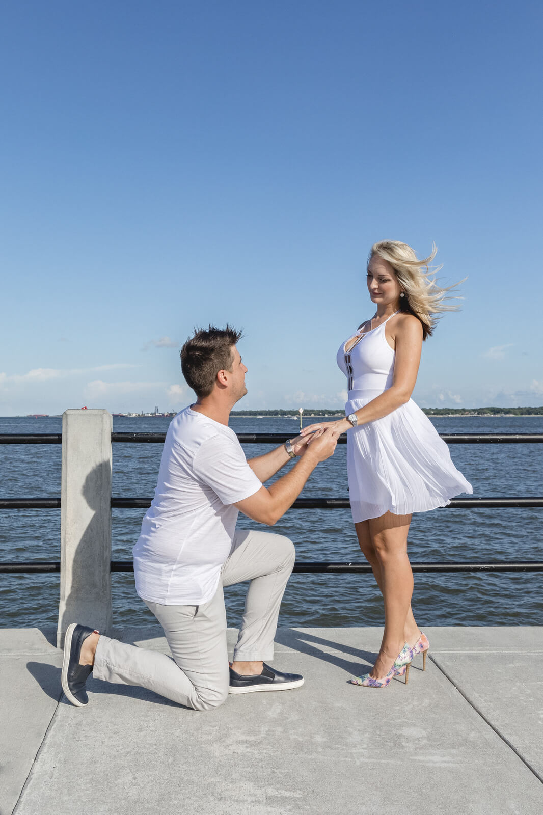 engagement photo Charleston the moment of proposal near photo they both wearing white