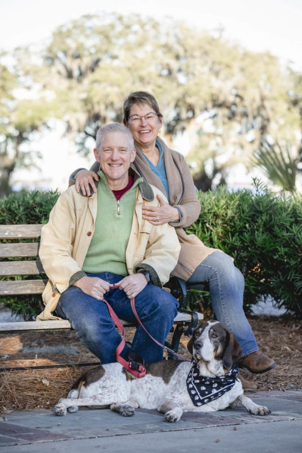 Charleston dog photo couple and their dog sitting on the bench