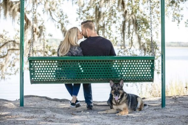 Charleston dog photo couple on the swing and their dog sitting near