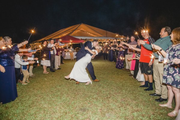 Charleston wedding photo bride and groom kissing surrounded with the Bengal lights