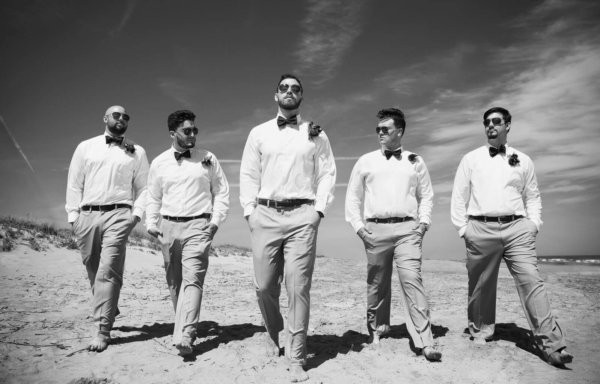 Charleston wedding black and white photo of groom and his friends on the beach
