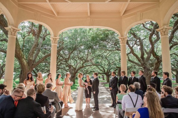 Charleston wedding photo bride and groom during ceremony in gazebo
