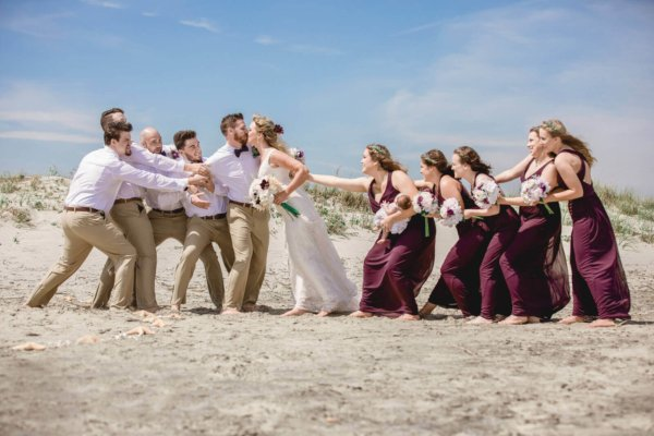 Charleston wedding photography bride and groom's friends are trying not to let them kiss