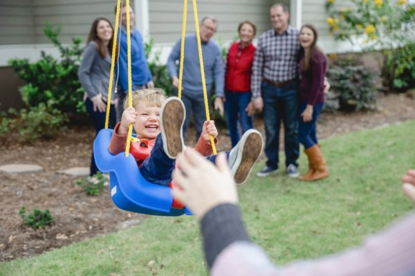 family photo charleston child is sitting in swing and laughing